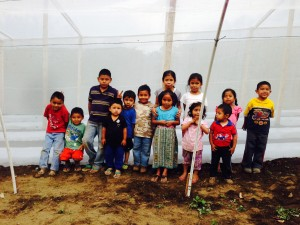 Children in front of the newly constructed greenhouse